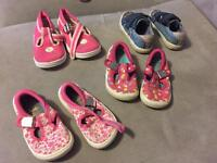 Four pairs of baby girls shoes. Size 3.