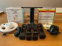 Wii console with 27 games 2 controllers, microphone, racing wheel and nunchuck excellent condition