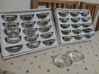 32 Glass Tea Light Holders and 25 white tea light candles