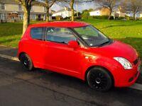 Great little car! Red Suzuki Swift 1.3l