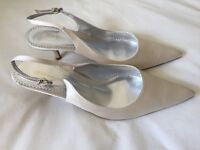 Brand new Ivory sling back shoes