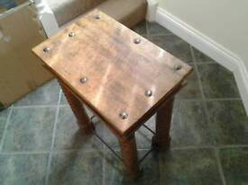 Occassional hardwood table.