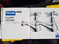 Set of Plumb sure Crystal chrome taps: basin, bath shower mixer and basin mixer