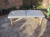 Massage / Reiki table. Portable with solid wood frame. Adjustable height