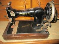Harris E Antique sewing machine and cover.