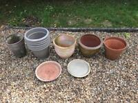 Assortment of plant pots and a bird bath
