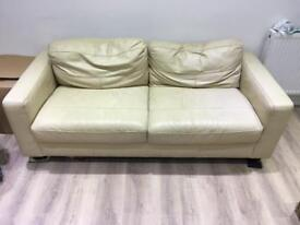 2x cream leather sofas