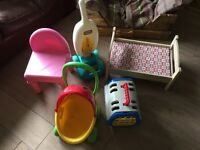 Selection of toys and plastic chair little tikes