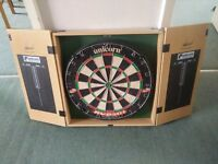 UNICORN Dart board and case and 3 sets of dards brand new