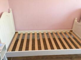 White wooden single bed frame.