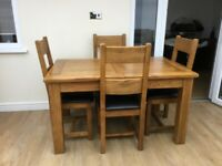 SOLID WOOD OAK DINING TABLE AND FOUR CHAIRS