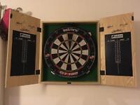 Dart board in cabinet