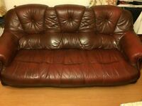 Sofas - 3 sets of 3 large seated sofas, real leather (burgandy colour) and wooden bottom legs