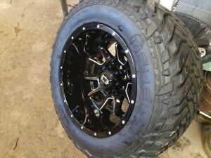 20x12s Vision bomb rims with 35x13.5x20 Fuel grippers m/t tires