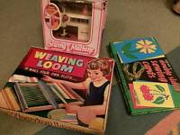 Retro toy sewing machine, weaving loom and sewing cards.