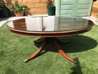 Large oval coffee table with glass top