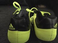 Neon yellow Adidas Astro turf trainers