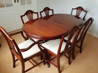 John E Coyle Mahogany extending dining table and 6 chairs