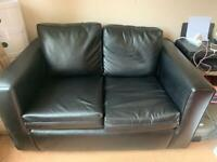 2 seater black sofa 4 months old