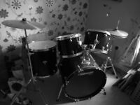 Tornado drum kit in excellent condition with full set of pads, stool and music stand.