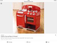 A red retro children's kitchen