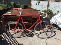 Red Raleigh road bike with single speed, new seat and tyres