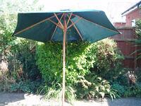 Wooden and green fabric garden parasol