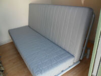 IKEA SOFA BED. Beddinge 3 seater sofa bed with grey cover and storage box.
