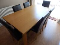 Dining room table and six faux leather chairs