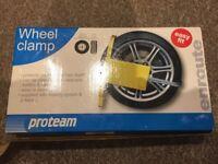 Brand new Wheel clamp.