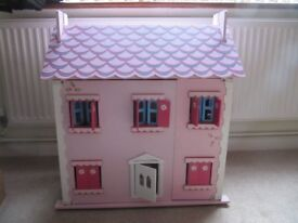 Dolls House in good condition with many pieces of furniture. Some marks on the roof as in the photo