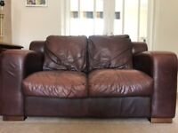 2 seater chocolate brown leather sofa.