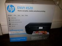 A HP ENVY printer up for quick sale