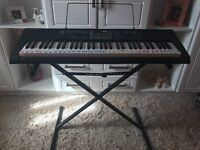 Casio LK-125AD Key Lighting Keyboard and stand. PRICE negotiable