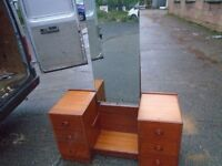 vintage dressing table with unusual mirror.
