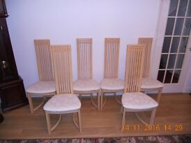 6 High Backed Dining Chairs. Very elegant and Arte deco style. light wood!