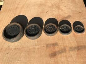 Set of cast iron imperial weights.