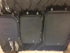 Trio of fiore suitcases