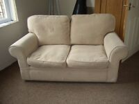 2 SEATER SOFA LIGHT CREAM. USED WITH LIGHT WEAR VERY COMFY