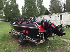 Red and black fast fletcher speed boat