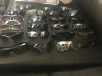 23 pairs of sunglasses