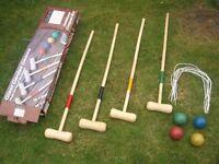 Wooden croquet set in box.