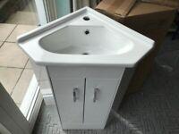 Corner sink with vanity cabinet