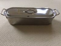 Long stainless steel fish poacher with rack and lid