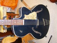 very large old archtop acoustic guitar