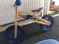 Boy's Kidzmotion Ooowee wooden balance bike