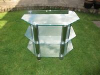 TV Stand in Glass & Chrome. 60cm width x 42cm in depth x 50cm height. Romford, Essex - £10.00