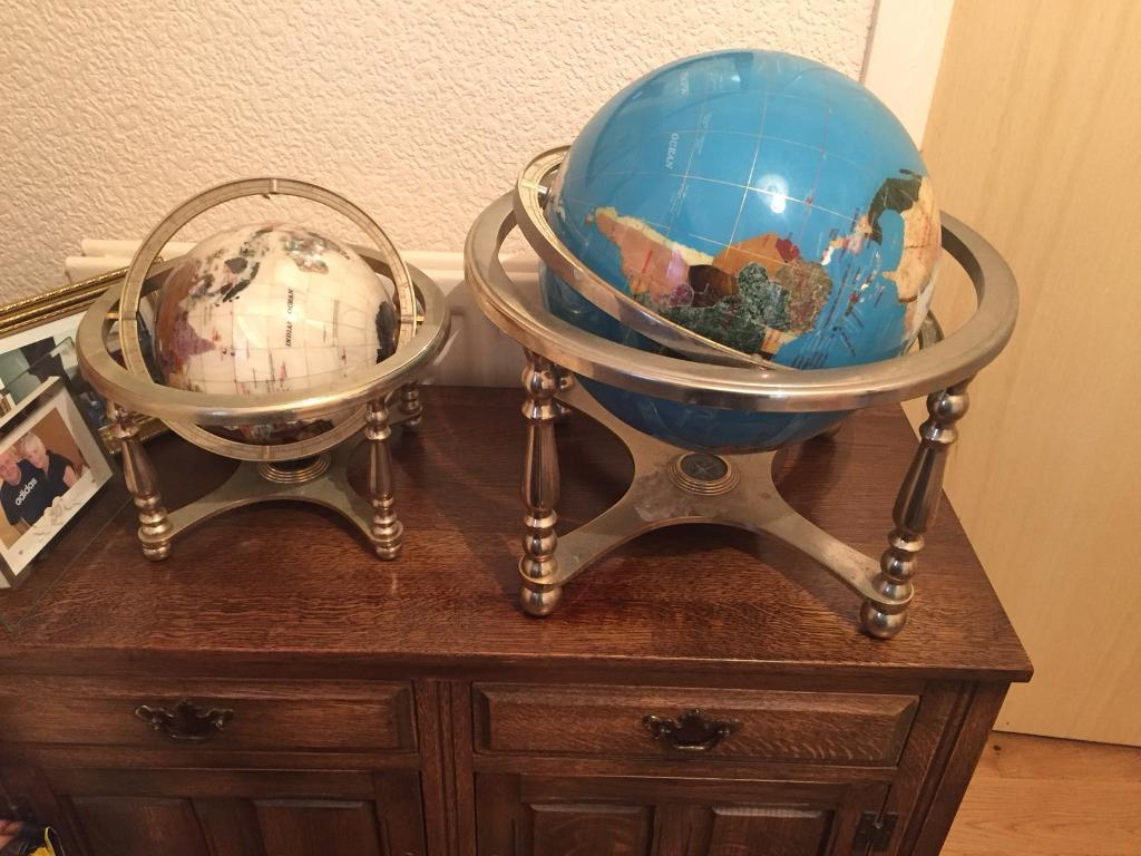 Two world globes , on brass stands