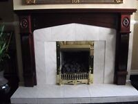 For sale: Tiled Fireplace with mahogany surround.