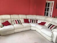 Leather corner sofa with extendable footrests